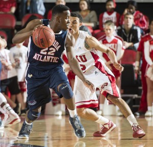 Senior guard Greg Gantt protects the ball. He finished with 22 points. Photo by Western Kentucky University Media Relations.