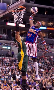 "Showman Kevin ""Special K"" Daley of the Harlem Globetrotters scoring a basket on the Washington Generals. Photo courtesy of Harlem Globetrotters."