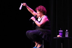 Comedian Maria Falzone gives instructions on how to use female condom. Photo by Daniel Cardenas.