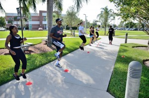 Bootcamp participants do cardio exercise under the guidance of instructor Kamal Cudjoe. Photo by Ryan Murphy.