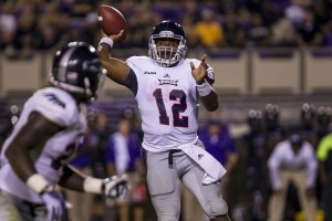FAU quarterback Jaquez Johnson throws downfield during Thursday night's game against East Carolina. The Owls lost to ECU 31-13 in their Conference USA debut. Photo courtesy of Rob Goldberg Jr./ECU Media Relations.