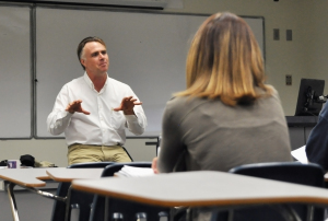 James Tracy introduces himself in his first class of the semester following the media coverage of his blog posts about the Newtown shooting.