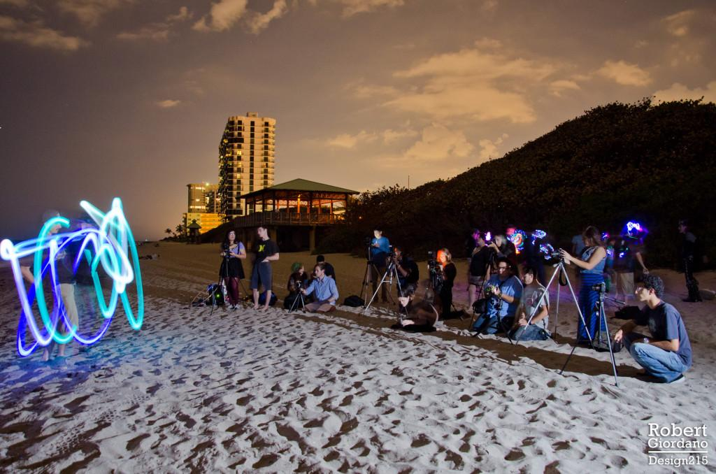 Courtesy of Robert Giordano Members of Owl Photography Club photograph a glow poi artist on Tuesday, February 11 at Palmetto Beach.