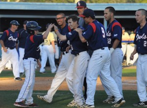 Pinch runner Geoff Jimenez (center) is congratulated by the bat boy (left) and his team after scoring the winning run during Saturday's game. The Owls beat FIU 6-5 by catcher Mike Spano's walk-off single in the bottom of the ninth, driving in Jimenez. Photo by Michelle Friswell.