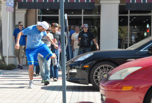 """During Zdorovetskiy's meet and greet (above and below), fans took part in """"the invisible box"""" prank, where they would pretend there was an object in front of the car to get a reaction from the driver. Photo by Michelle Friswell."""