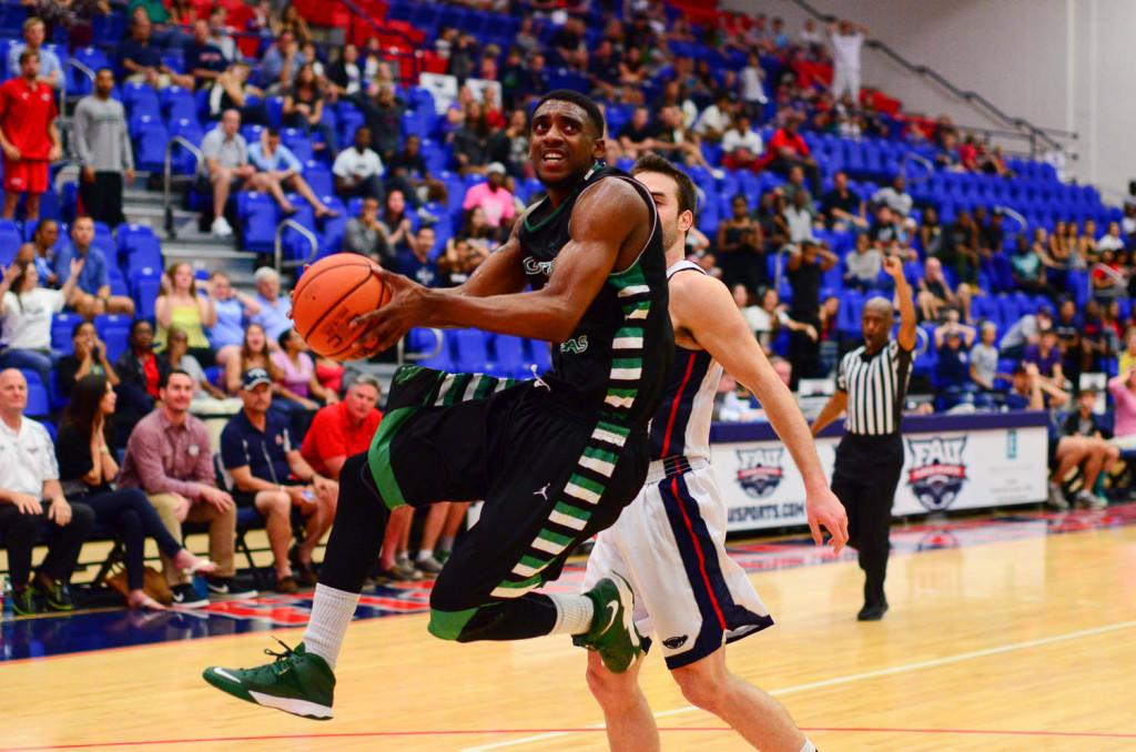 Max Jackson  |  Photo Editor UNT guart Alzee Williams eyes the rim just before attempting a layup.