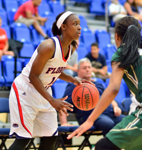 Latavia Dempsey surveys the perimeter. Dempsey scored 24 points in the loss. Photo by Ryan Murphy