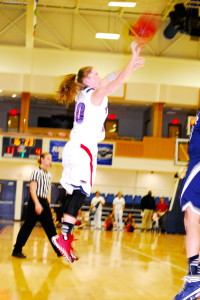 Kimberly Smith launches a three pointer from the right wing. Photo by Ralph Landau
