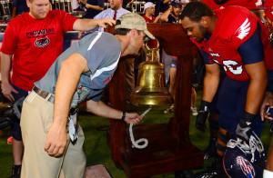 Owls interim head coach Brian Wright rings the Taylor Victory Bell for his first time after the Owls win over NMSU.