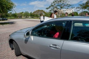 FAU President Mary Jane Saunders drives away from a March 22 protest on the Jupiter campus moments before her side mirror brushes senior Women's Studies major Britni Hiatt. Photo courtesy of Britni Hiatt.
