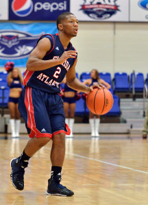 Owls guard Marquan Botley moves the ball down court during the second half. Botley scored 12 points with five assists. Photo by Ryan Murphy.