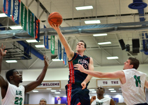 Guard Jackson Trapp attempts a layup in the first half. Trapp led the Owls Friday night with 23 points. Photo by Ryan Murphy.