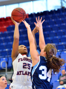 Owls center Chenise Miller shoots past Rhode Island forward Samantha Tabakman. Miller led the Owls with 16 points against the Rams Saturday, in the final game of the FAU Thanksgiving Tournament.