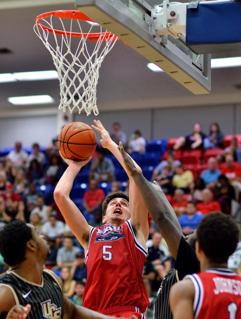 Javier Lacunza tries to finish through contact during a Dec. 3 game versus UCF. Photo by Ryan Murphy