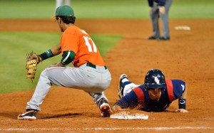 First baseman Mark Nelson slides back to first to avoid being picked off. The Owls lost to Miami 5-4 Wednesday night. Photo by Ryan Murphy.
