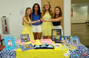Representatives of Alpha Xi Delta. Chapter President Allie Wessel, Lena Sharff, Membership Vice President Morgan Donnelly, and Demi McGinn. Photo by Tami Lacoste.