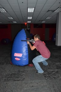 Nick Voils, senior exercise science major takes cover while firing on an enemy. Photo courtesy of Austen Erblat.