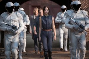Haymitch Abernathy (Woody Harrelson, left), Peeta Mellark (Josh Hutcherson, center), Katniss Everdeen (Jennifer Lawrence, right) in The Hunger Games: Catching Fire. Photo by Murray Close/Lionsgate