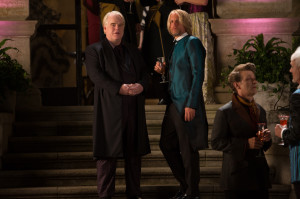 Plutarch Heavensbee (Philip Seymour Hoffman, left) and Haymitch Abernathy (Woody Harrelson, right) in The Hunger Games: Catching Fire. Photo by Murray Close/Lionsgate